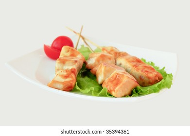 Grilled meat on wooden sticks (isolated with clipping path)