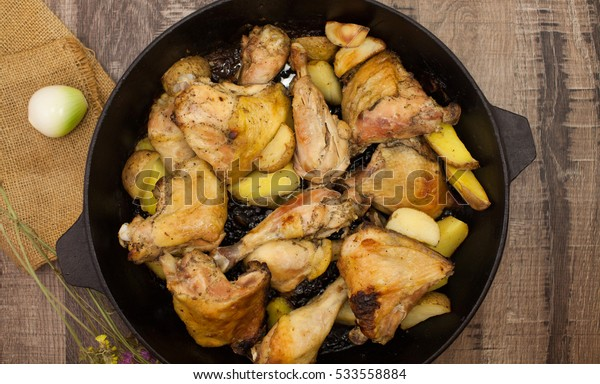 grilled meat with potatoes.  chicken quarters. roasted chicken. fried chicken legs.