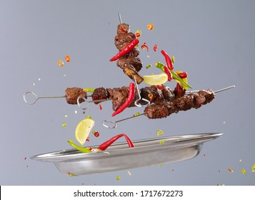 Grilled meat skewers in the air and spicy ingredients and stop the movement of barbecue concepts.