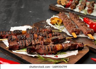 Grilled meat skewers barbecue served on board. Kebab meat