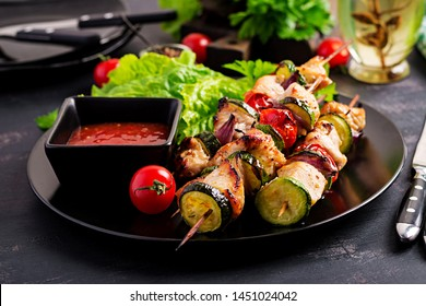 Grilled meat skewers, chicken  shish kebab with zucchini, tomatoes and red onions. Barbecue food.