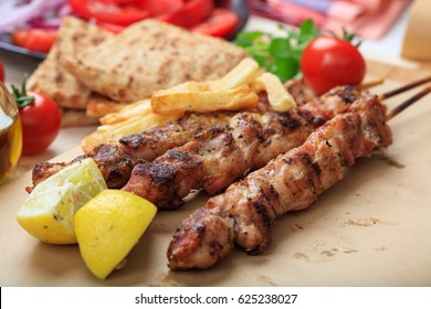Grilled meat skewers on a baking paper