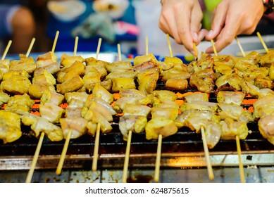 Grilled meat skewers preparation.