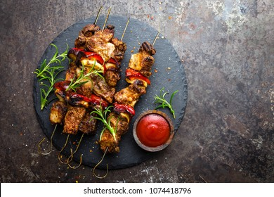 Grilled meat skewers, shish kebab with onion and sweet pepper