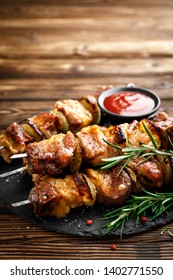 Grilled meat skewers, shish kebab on wooden background