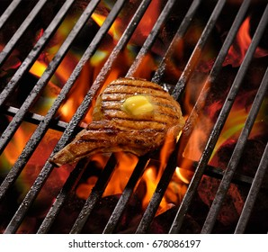 Grilled meat /steak with butter on top on the flaming grill