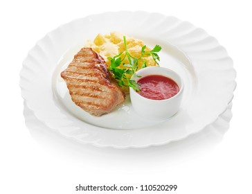 Grilled meat with trimmings isolated on a white background