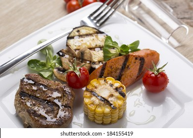 grilled meat with grilled vegetables on the plate decorated for restaurant menu