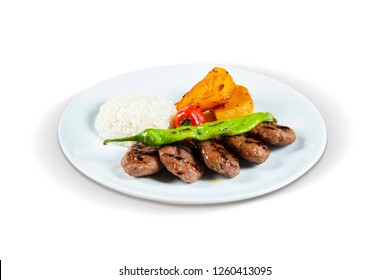 Grilled Meatballs, Rice, Boiled Potatoes with Tomato and Pepper, White Background, with clipping path included (TR: Izgara Kofte, Pilav, Haslanmis Patates, Domates ve Biber ile)