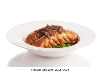 Grilled mixed sausage with gravy and mustard sauce, isolated on white.