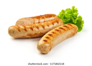Grilled Munich sausages with green lettuce, isolated on white background