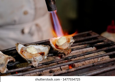 grilled oyster on japanese shichirin grill.