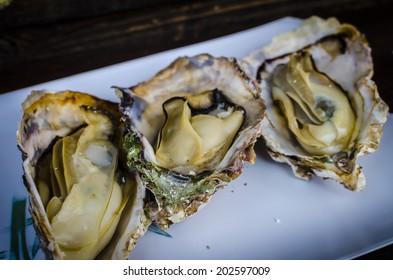 Grilled oysters at Miyajima island , Japan