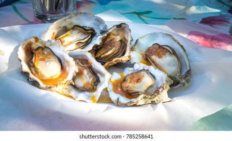 Grilled Oysters in Sauce