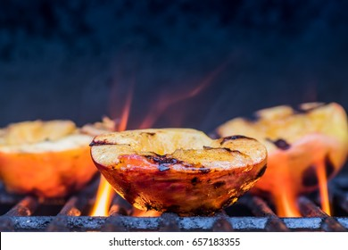 Grilled Peaches and Flames caramelize during a summer cookout