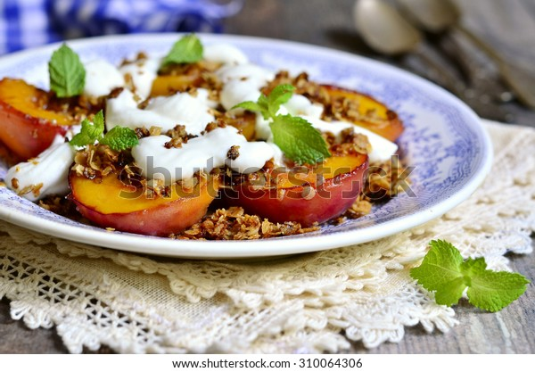 Grilled peaches with granola and whipped cream for breakfast.