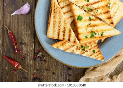 Grilled pieces of white bread on a plate. Toast for sandwiches.