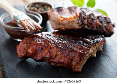 Grilled pork baby ribs with barbecue sauce