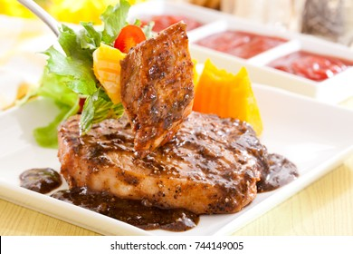 Grilled Pork  with black pepper sauce.