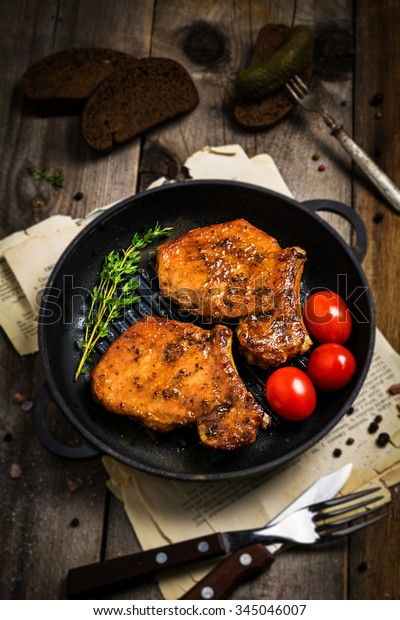 https://image.shutterstock.com/image-photo/grilled-pork-chops-sweet-honey-600w-345046007.jpg