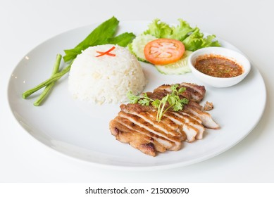 Grilled pork with garlic fried rice and spicy dipping sauce.