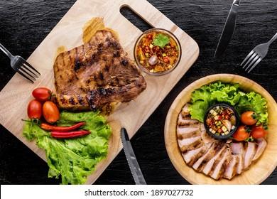 Grilled pork jowl favorite Thai street food on dark background