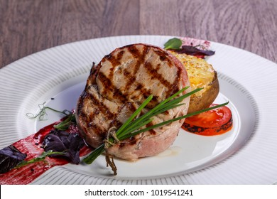 Grilled pork loin with baked potato