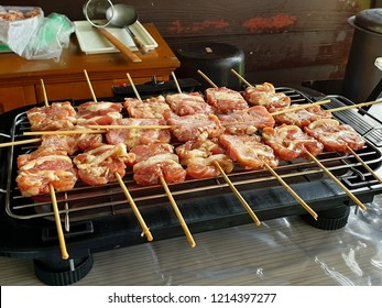 Grilled pork on the flaming grill