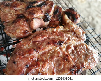 Grilled pork on a grill