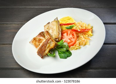 grilled pork on a plate on wooden table