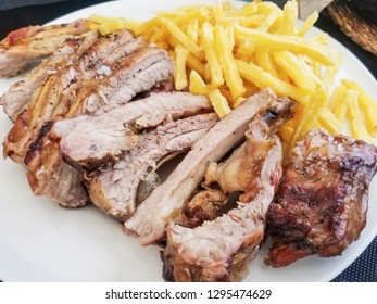 Grilled pork rib with fried potatoes