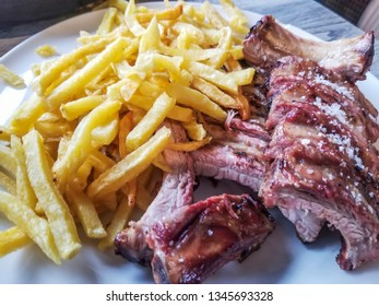 Grilled Pork rib with fried potatoes traditional galician recipe