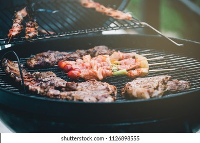 Grilled pork ribs and barbecue on the grill in the party