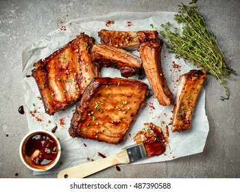 grilled pork ribs on white baking paper, top view