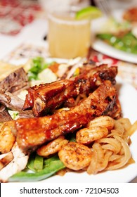 Grilled pork ribs and shrimps with coctail - perfect dinner