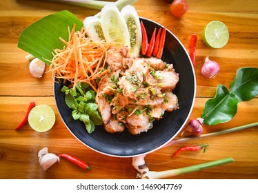 Grilled Pork Salad Thai food served on table with herbs and spices ingredients / Tradition northeast food Isaan delicious with fresh vegetables - Hot and Spicy Slice grilled pork menu Asian food