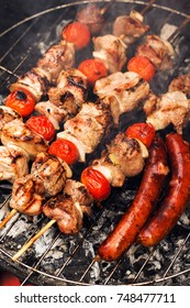 Grilled pork skewers and sausages, selective focus