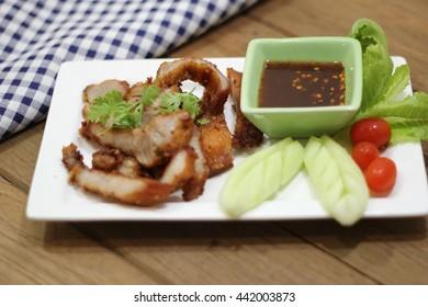 Grilled pork steak with spicy sauce, Thai food
