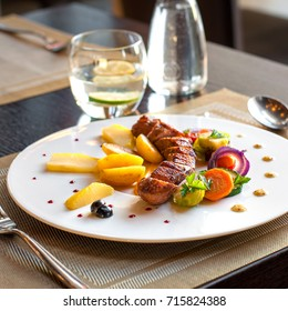 Grilled pork tenderloin dish with roasted vegetables
