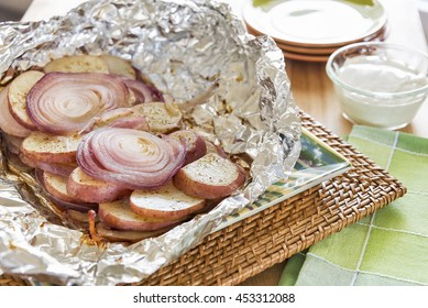 Grilled potatoes and onions wrapped in a foil packet