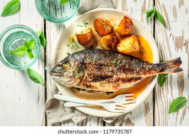 Grilled potatoes and seabream with cherry tomatoes and thyme