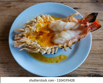Grilled prawn, the delicious seafood, on the blue plate and wooden table