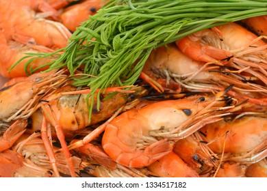 Grilled prawns in foam tray, Leucaena leucocepphala.