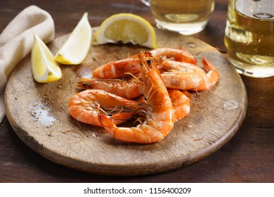 grilled  prawns with fresh lemon on wooden plank
