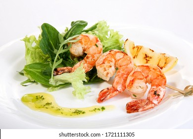 grilled prawns with lettuce and lemon