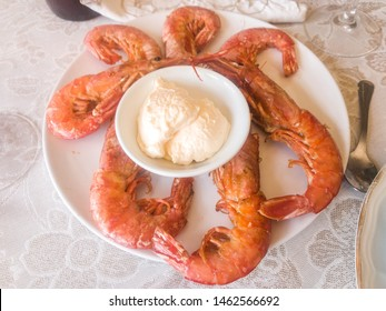 Grilled prawns on bbq with mayonnaise