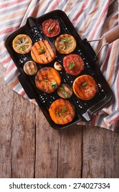 Grilled pumpkin and vegetables on the grill pan. vertical view above, rustic style