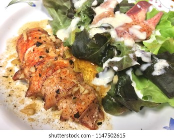Grilled red lobster black pepper sauce seafood with green vegrtable salad homemade food