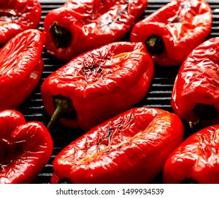 Grilled red peppers on a grill plate, close-up.  Vegetarian organic food