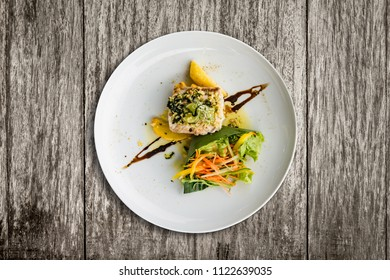 Grilled red snapper with garlic butter sauce, Balinese sauce salad and crispy potato chips.